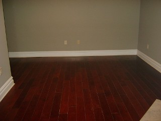 Bedroom with Wood Flooring - Before