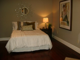 Bedroom with Wood Flooring - After