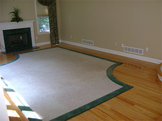 Living Room with Fireplace and Rug Before