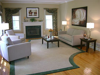Living Room with Fireplace and Rug After