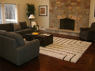 Living Area with Large Stone Fireplace After