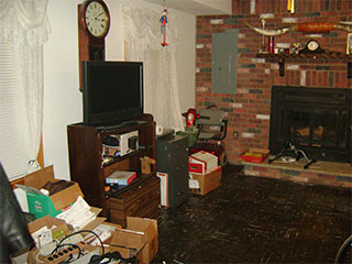 Large Living Room with Brick Fireplace Before
