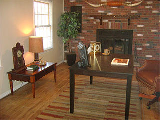 Large Living Room with Brick Fireplace After